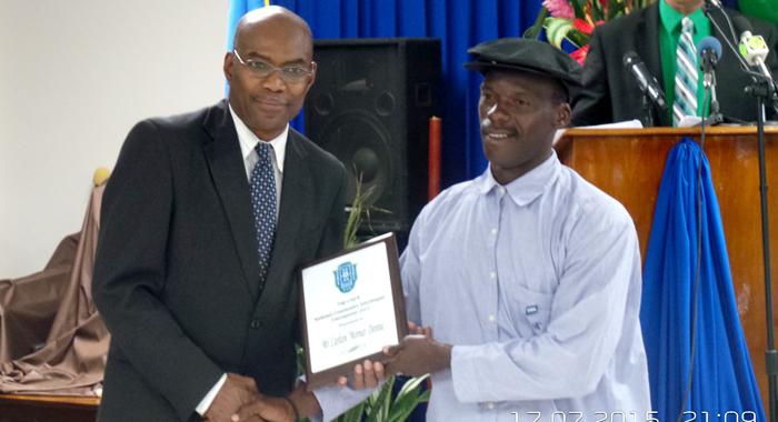 Featured Speaker Dr. Lennox Adams Presents An Award To Top Coach Carlton &Quot;Morna&Quot; Dennie. (Photo: E. Glenford Prescott)