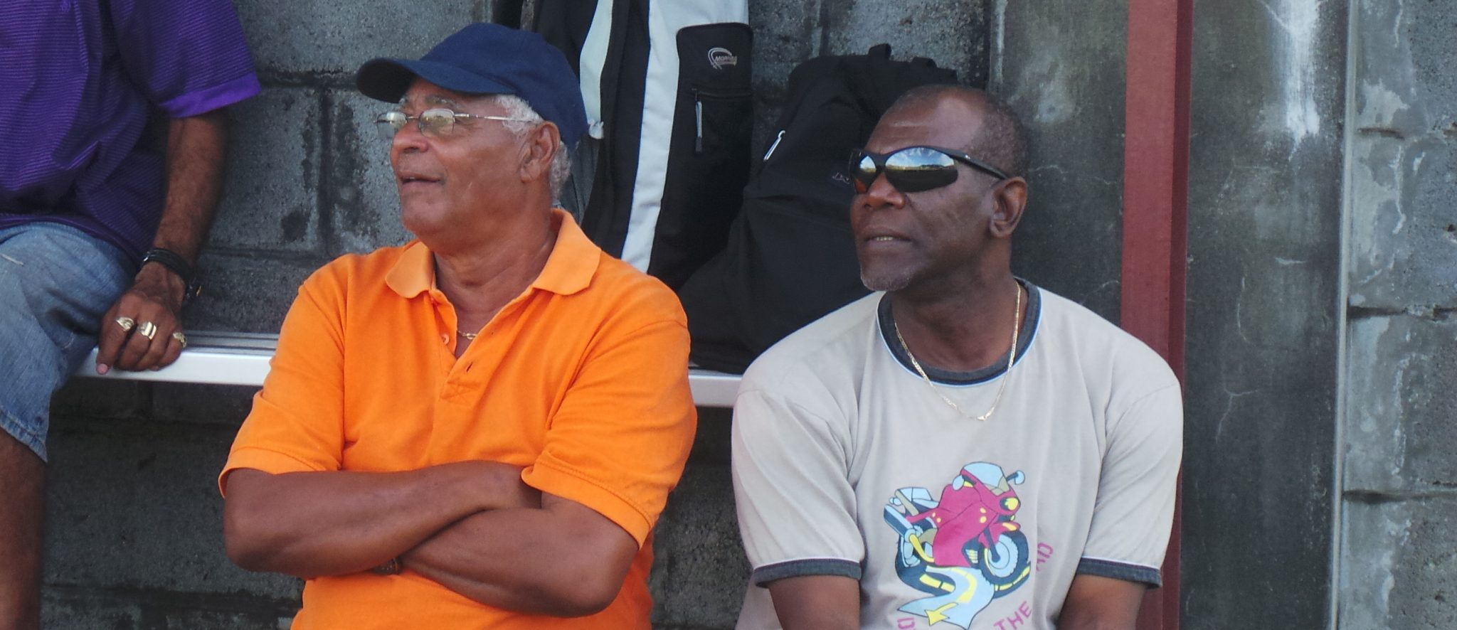 Allen, Left, And Saints Team Manager Foster Huggins Take A Keen Interest In On-Field Action.