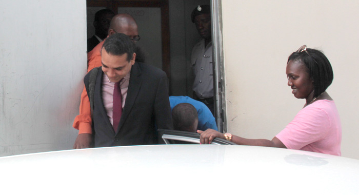 John, In Blue, Hides Behind His Lawyer, Ronnie Marks, As He Exits The Court Building. (Iwn Photo)