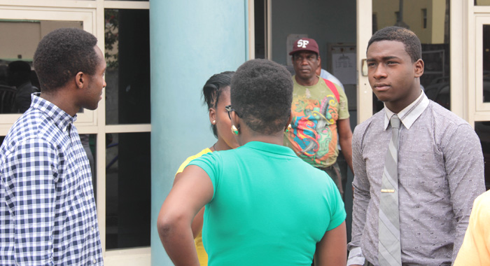 Shabazaah George, Right, Interacts With Persons After Monday'S Court Appearance. (Iwn Photo)