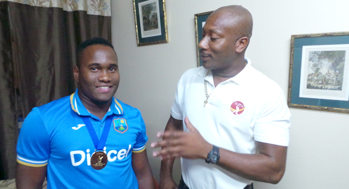 Vincentian Cricket Star Gidron Pope And His Mentor, Nixon Mcclean. (Photo: E. Glenford Prescott)