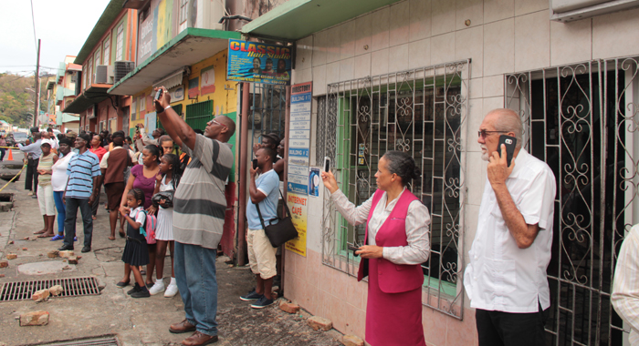 Minister Of Works, Sen. Julian Francis, Right, And Other Onlookers At The Scene. (Iwn Photo)