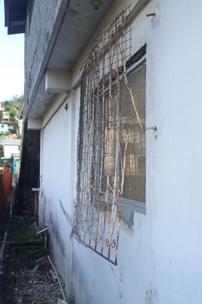 Burglars Entered The Supermarket After Prying Off The Burglars Bars From A Window. (Iwn Photo)