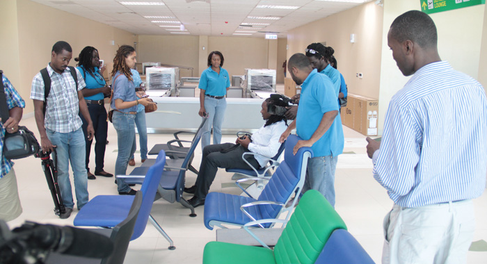 Media Workers Discuss The Sample Seats At The Airport During A Tour Of The Terminal Building On Friday. (Iwn Photo)