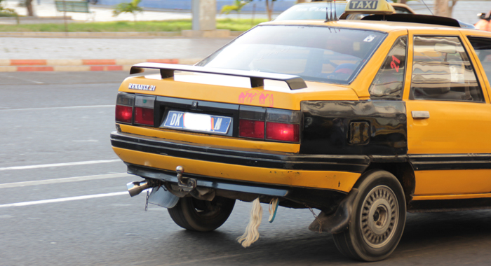 Many Taxis And Some Private Vehicles Have Some Horsehair And A Foot Of Children'S Footwear Attached To The Rear Underside Of The Vehicle. It Is Said That The Belief Is That The Paraphernalia Helps To Prevent Accident, When Increasing The Speed Of The Vehicle... (Iwn Photo)