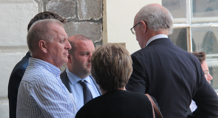Dave Ames, Left, And His Wife, Carol Chat With Lawyers For Harlequin Outside The High Court On Tuesday. (Iwn Photo)