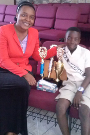 With The 2016 Top Performer In Cpea And Valedictorian Of The Sion Hill Government School, Javed Baptiste.