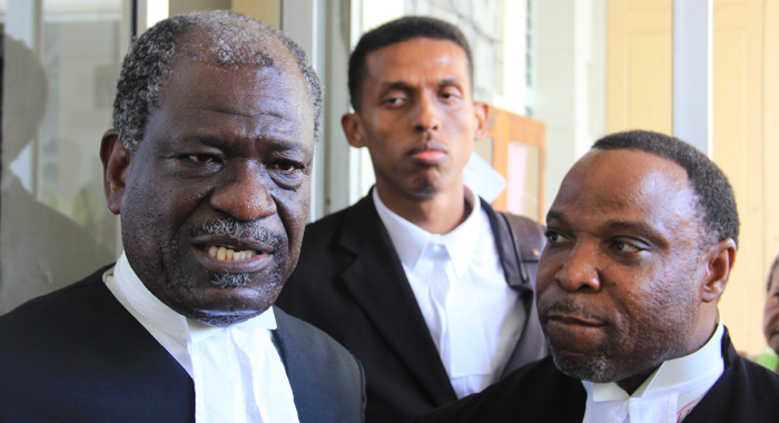 Ndp Lawyer, Stanley &Quot;Stalky&Quot; John, Qc, Right, A Keith Scotland, Speak With Reporters Outside The Court On Thursday. (Iwn Photo)