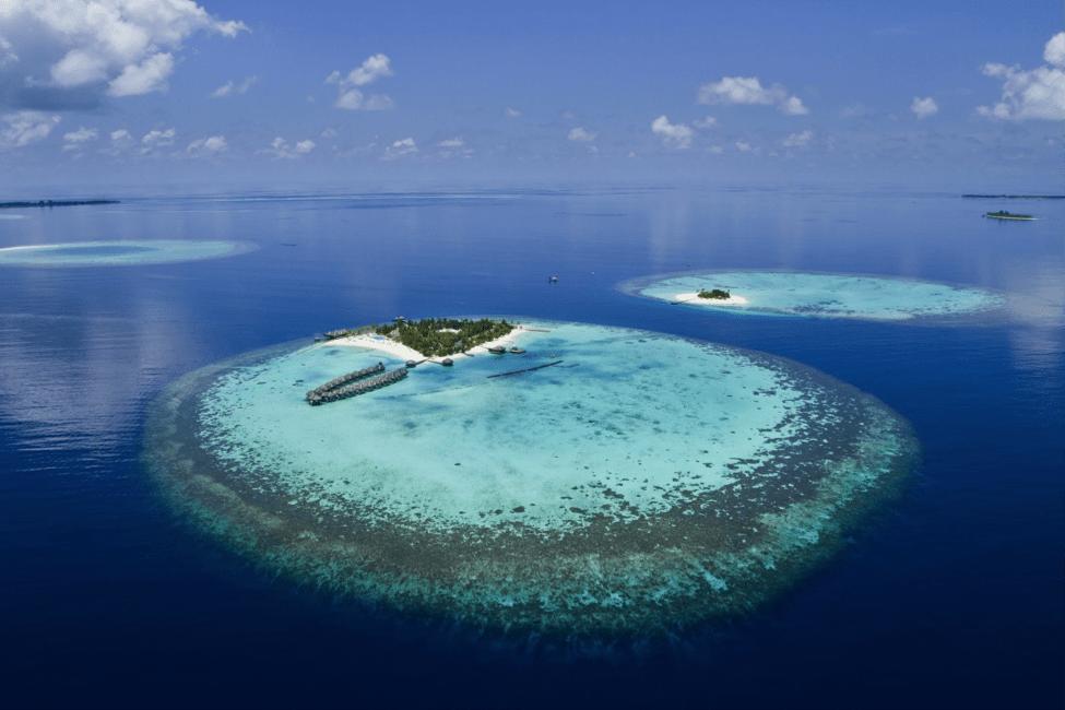Another Maldives Island Resort And Surrounding Atoll.