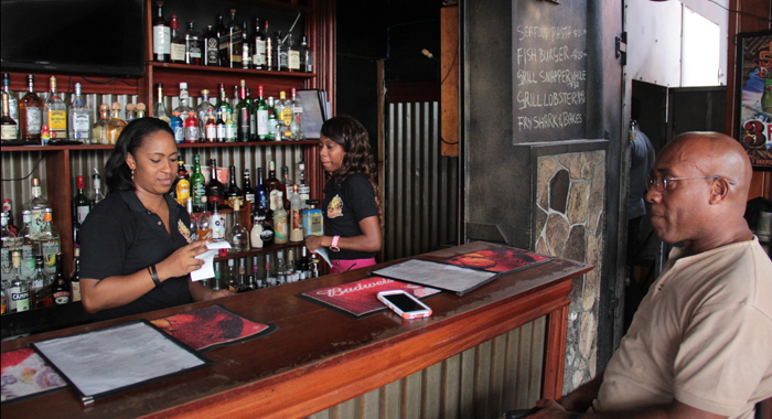 Two Chill Spot Employees And A Customer At The Restaurant On Friday. The Employees Could Be On The Breadline Come Friday. (Iwn Photo)