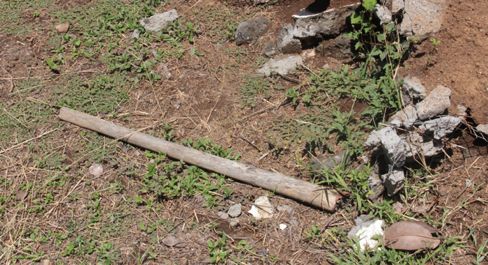 A Pick Handle Was On Thursday Near One Of The Graves That Were Desecrated. (Iwn Photo)