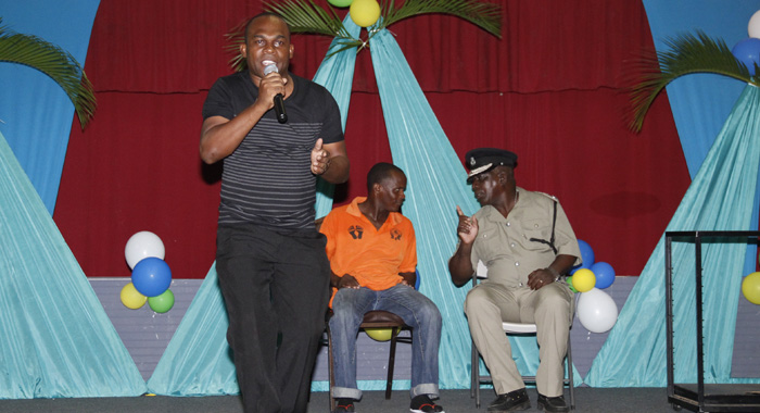 Retired Police Chief, Michael Charles, Left, Supported The Show By Making A Guest Performance, As Well As Appearing During Artistes' Performance, As He Did Here, During One Of Renrick &Quot;Mighty Bamboo Joint&Quot; Cato'S Rendition. (Iwn Photo)