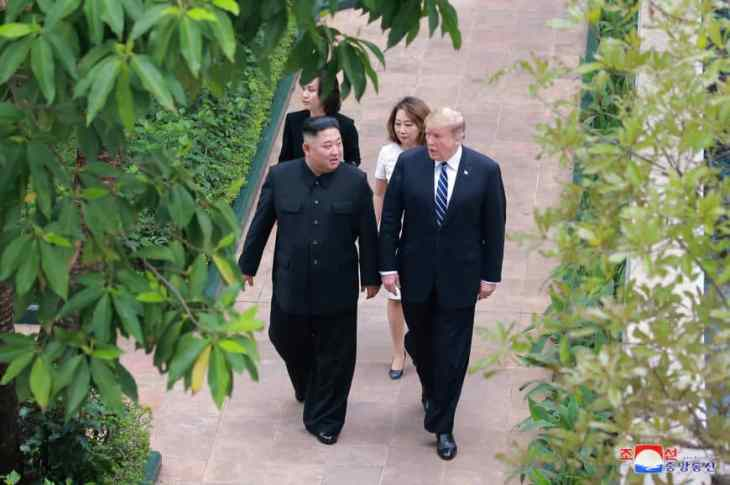 North Korean leader Kim Jong Un walks with U.S. President Donald Trump during their second summit in Hanoi on Friday in a photo released by the Korean Central News Agency. | KCNA /REUTERS