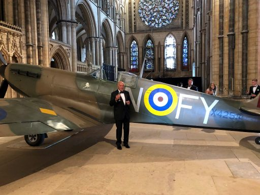 Terry Coffey, business owner, with the Spitfire