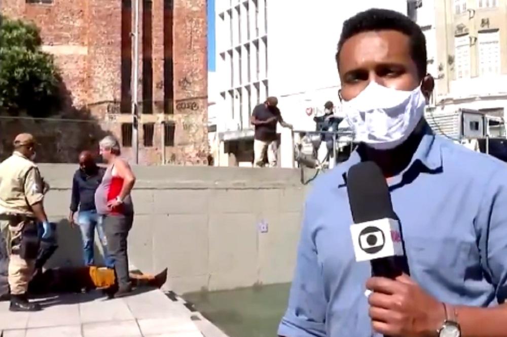 Repórter da Globo entra na água e ajuda funcionário da prefeitura ...