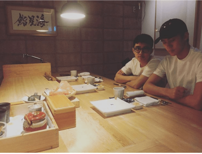 D.O. and Sehun at Restaurant / Sehun's Instagram