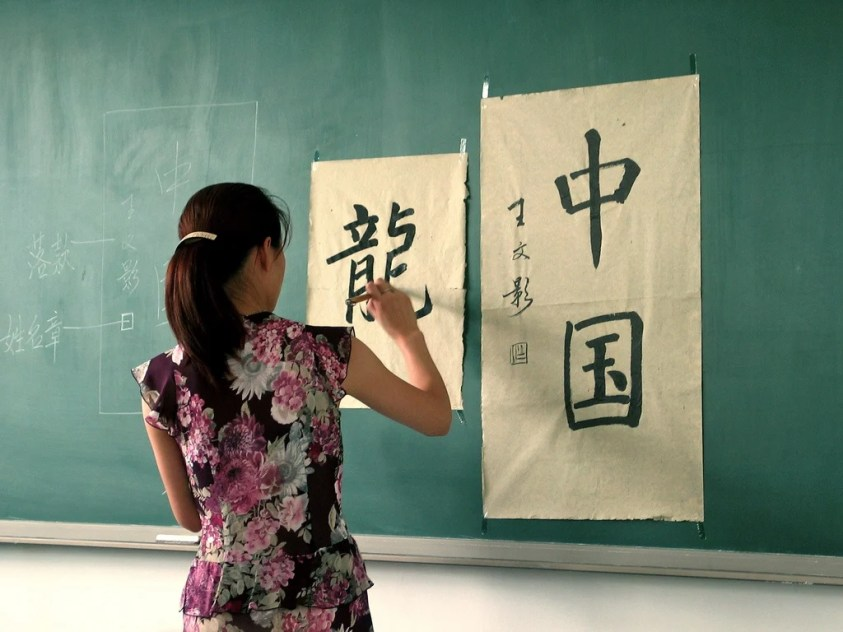 Woman writing chinese calligraphy