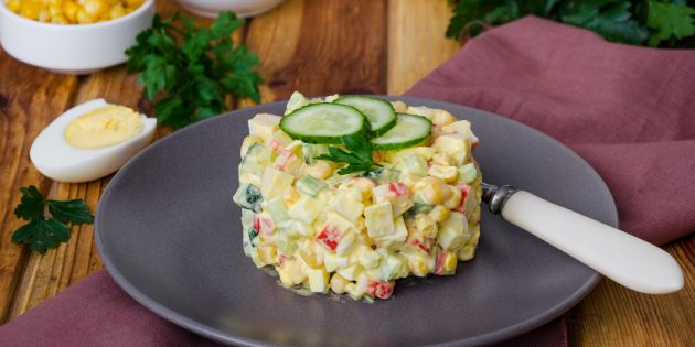 Salad with crab chopsticks, pickled and fresh cucumbers, corn and eggs: Simple recipe