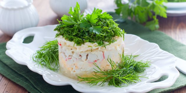 Simple salad recipe with crab chopsticks, pineapples, cheese and eggs