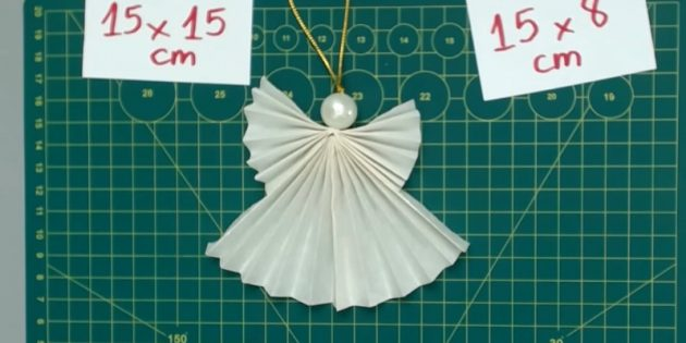 Tillsätt pärlan och räta ut papperet