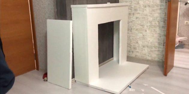 Декоративный камин своими руками: установите камин на основание и приклейте его