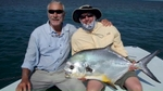 Saltwater fly fishing guide and a large permit Florida and Marquesas Keys.