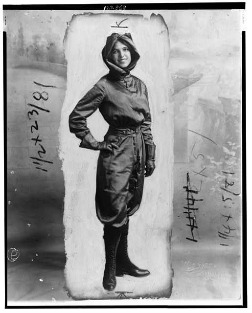[Harriet Quimby, full-length portrait, standing, in aviation costume]