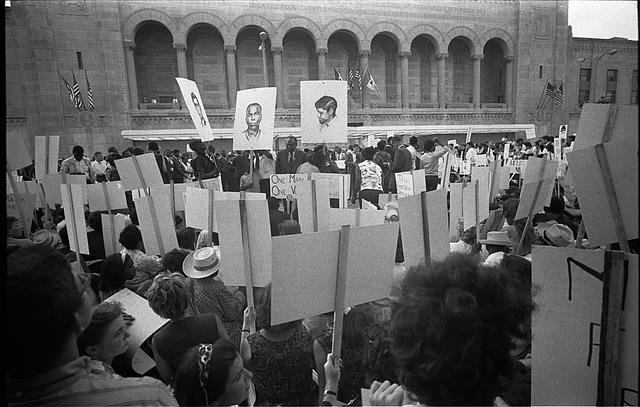 [African American and white Mississippi Freedom Democratic Party supporters demonstrating outside the 1964 Democratic National Convention, Atlantic City, New Jersey; some hold signs with portraits of slain civil rights workers James Earl Chaney, Andrew Goodman, and Michael Schwerner]