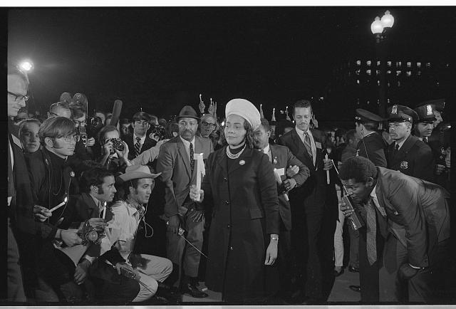 [Coretta Scott King holding a candle and leading a march at night to the White House as part of the Moratorium to End the War in Vietnam which took place on October 15, 1969]