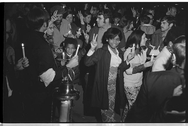 [Crowd of people holding candles, including African Americans, at a march at night to the White House, lead by Coretta Scott King as part of the Moratorium to End the War in Vietnam which took place on October 15, 1969]