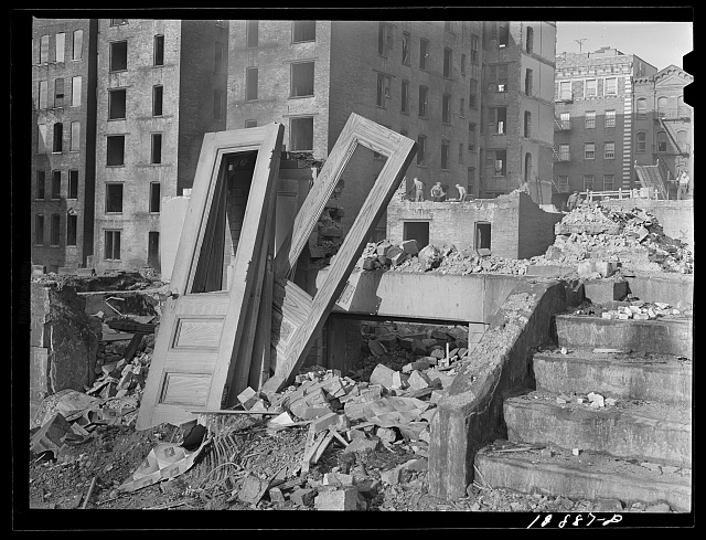 New York, New York. Demolition for slum clearance. Whole blocks of a slum area are torn down to make room for a housing project