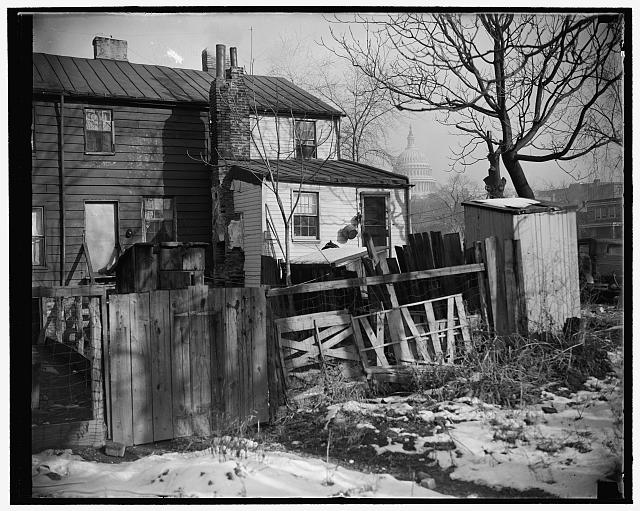 Capital slums to go under new low rent housing program. Washington, D.C., Nov. 30. Now that President Roosevelt has approved the $15,000,000 low rent housing program for the District of Columbia, such slum scenes as this will disappear from the 'city beautiful.' This picture was made within a stone's throw of the U.S. Capitol