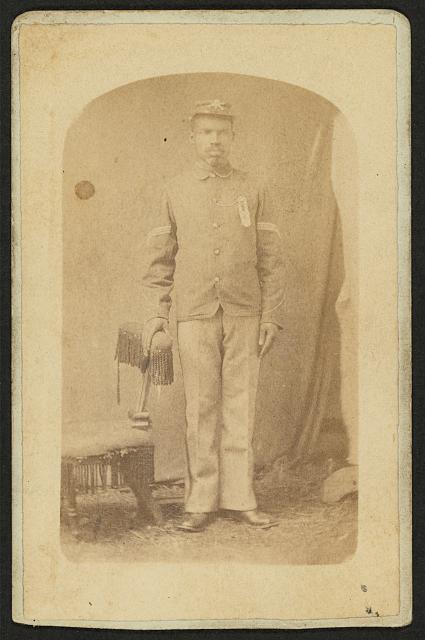 [Full length portrait of an African-American man, possibly a Buffalo soldier]