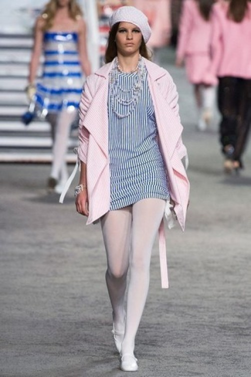 How to Wear White Tights: Why not consider pairing a pink vertical striped coat with white tights? Both items are very comfortable and look good married together. Introduce a pair of white leather ballerina shoes to the equation and the whole outfit will come together quite nicely.