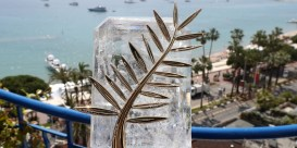 A photo taken on May 24, 2017 at the Grand Hyatt Cannes Hotel Martinez in Cannes, southern France, shows the Palme d'Or trophy inlaid with diamonds which celebrates the 70th edition of the Cannes Film Festival. / AFP PHOTO / Valery HACHE