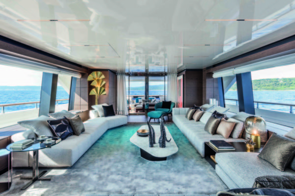 On the main deck, the enormous saloon features huge windows and seating that stretches along both sides