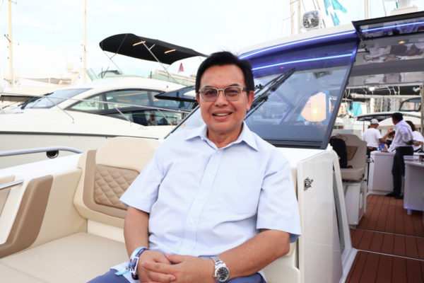 Tan Sri Dr Mohd Nadzmi Bin Mohd Salleh on his new Aquila 36 at the Singapore Yacht Show