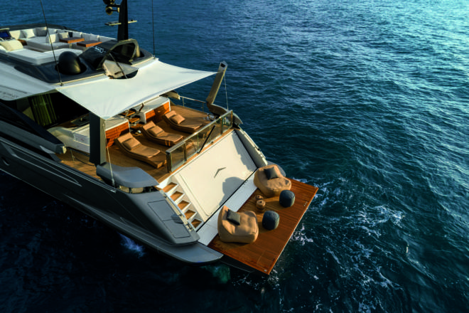 The aft deck of the Azimut Grande S10 features aft-facing loose furniture