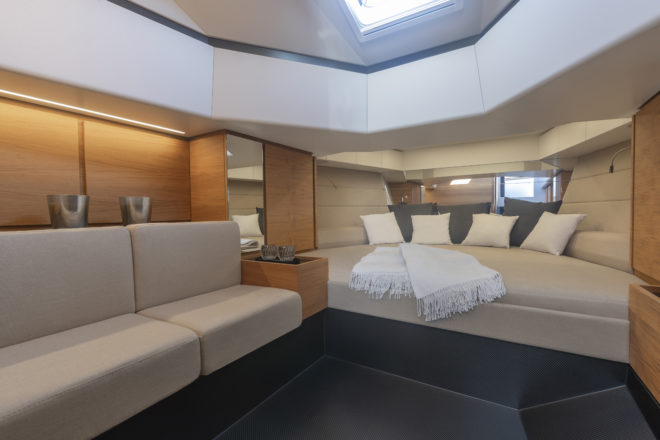 The full-height cabin is surprisingly spacious, with a bench seat to port