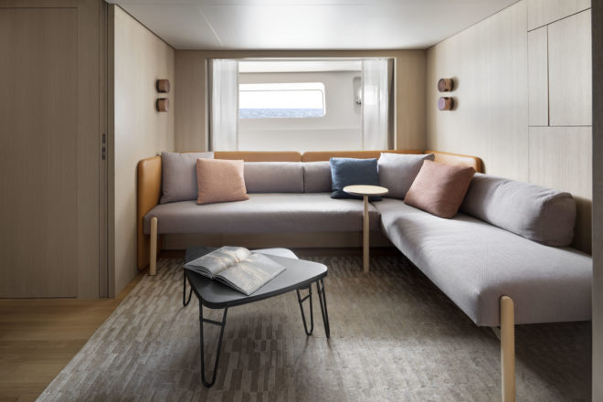 The lower deck features a living room that can convert to an en-suite cabin