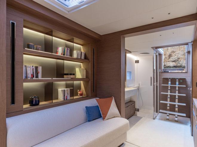 The master suite includes a 'library' and en-suite bathroom aft, plus cockpit access