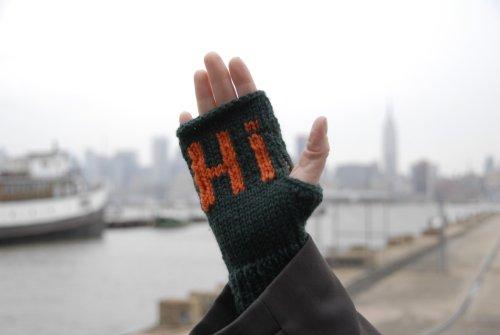 mitten that says hi
