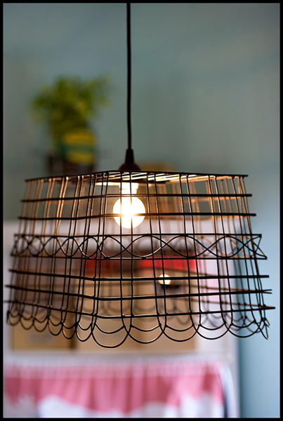 Diy wire basket pendant light make ashley ann was inspired by the wire lights at anthropologie and re created the look with her wire basket pendant light tutorial aloadofball Choice Image