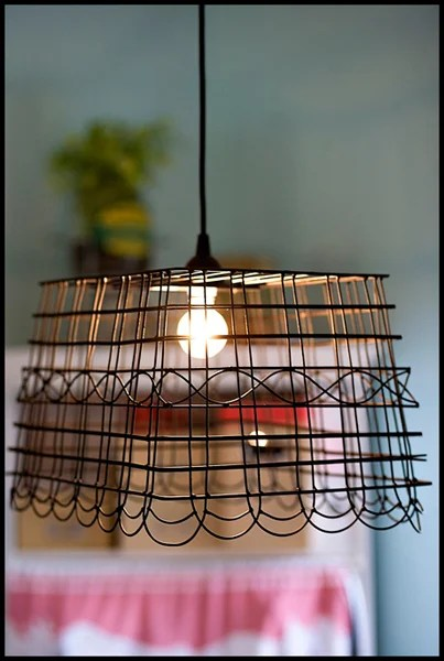Ashley Ann was inspired by the wire lights at Anthropologie and re-created the look with her wire basket pendant light tutorial. & DIY Wire Basket Pendant Light | Make: