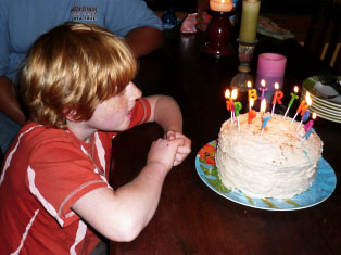 blowing_out_candles_snickerdoodle_cake.jpg