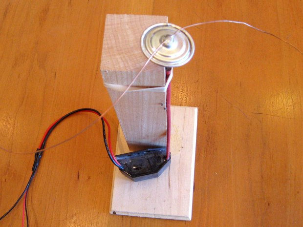 TINY ION: Replicate  the basics of an ion propulsion engine using a piece of wire, the cap from a D battery, and  a power source.