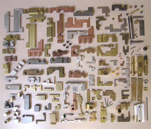 125-piece-puzzle-in-6-different-metals-with-hidden-golden-gun.jpg