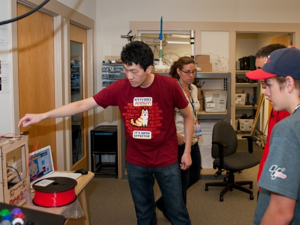 Engineering Intern Eric Chu showing off the MakerBot 3D printer.
