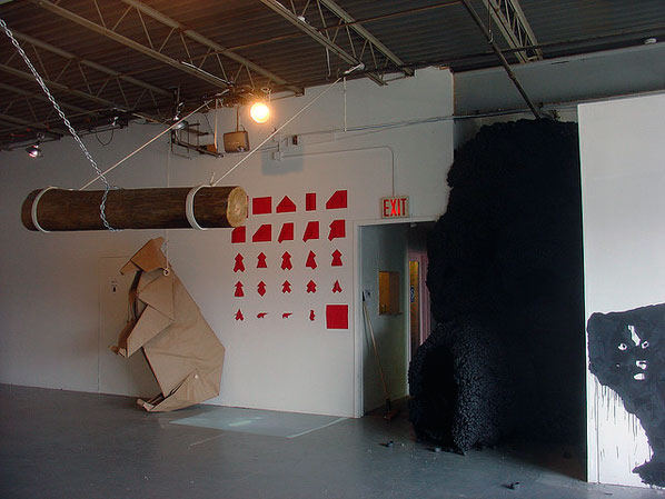 The life-size paper bear against the back wall took four people seven hours to fold!