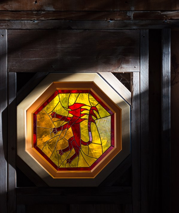 Rampant lion stained glass window made in the workshop in the 1980's for my family's Marin County house — now in the garage stairwell.